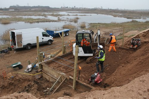 Sandinyoureye constructing the sand bank with Paul Afford plant hire on the digger.